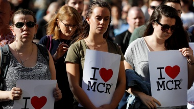 Women wait to take part in a vigil for the victims of an attack on concert goers at Manchester Arena, in central Manchester, Britain May 23, 2017. REUTERS/Darren Staples