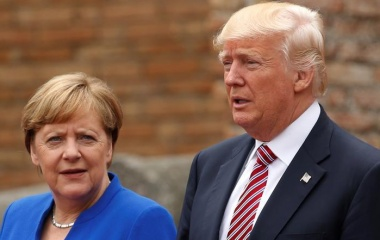 Tunisia's President Essebsi gestures to Trump as German Chancellor Merkel looks on at the G7 Summit expanded session in Taormina