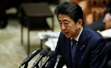 Japan's PM Abe denies favours for friend amid falling support