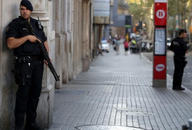 Spain hunts driver who killed 13, says foils bomb plot