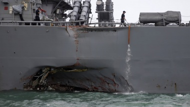 The guided-missile destroyer USS John S. McCain is seen after a collision, off Johor, Malaysia