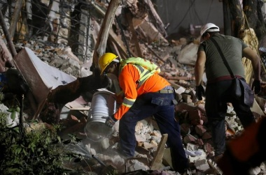 Desperate search in school, other ruins as deaths pass 200