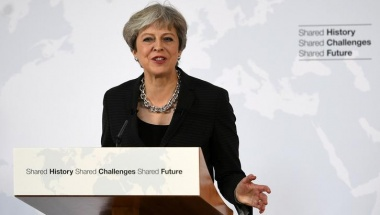 May sets out transition plan in bid to unlock Brexit talks