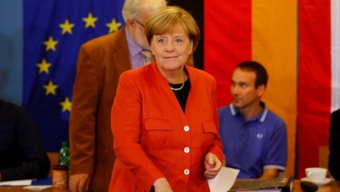 Merkel wins fourth term
