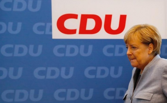 Merkel tries to build coalition after vote that puts far right in parliament