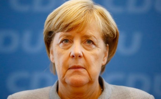 Chastened Merkel braces for coalition tussle