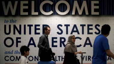 International passengers arrive at Washington Dulles International Airport after the U.S. Supreme Court granted parts of the Trump administration's emergency request to put its travel ban into effect later in the week pending further judicial review