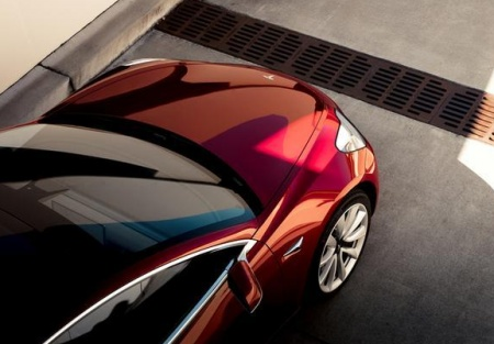 Tesla reaffirms effort to build cars in China
