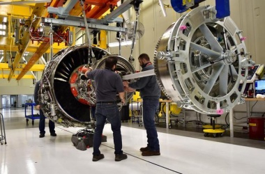 GE vows 'sweeping change' as profit falls