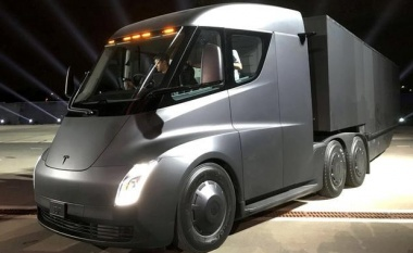 New Tesla Roadster speeds in front of electric big-rig truck