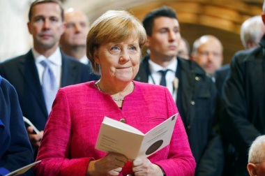 Analysis: Merkel looks secure for now despite coalition chaos