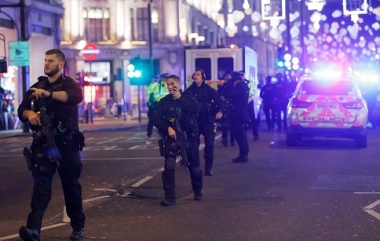Armed police race to London's Oxford Street