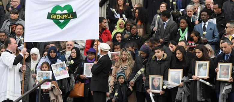 Six months on, Grenfell fire survivors weep at London memorial
