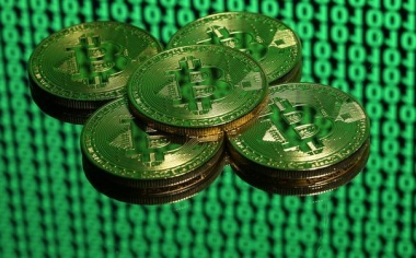 Bitcoin hits new record high as warnings grow louder