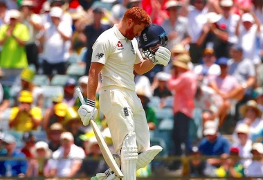 Bairstow celebrates Ashes ton with helmet headbutt