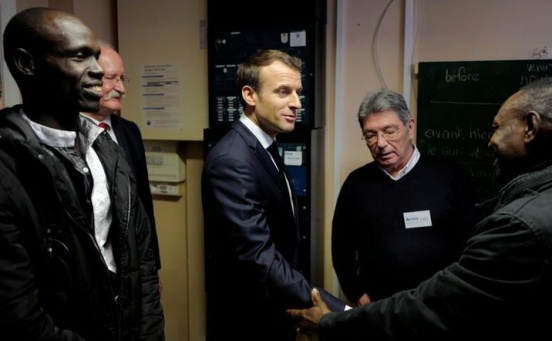 Ahead of UK summit, Macron visits migrants in port of Calais