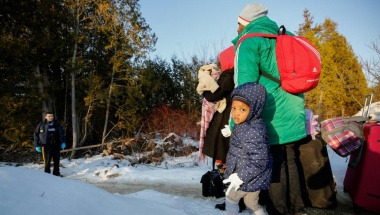 A girl waits with her family before crossing the US-Canada border into Canada in Champlain, New York, U.S., February 14, 2018.  REUTERS/Chris Wattie