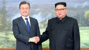 South Korean President Moon Jae-in shakes hands with North Korean leader Kim Jong Un at North Korea, in this handout picture provided by the Presidential Blue House on May 26, 2018. The Presidential Blue House /Handout via Reuters