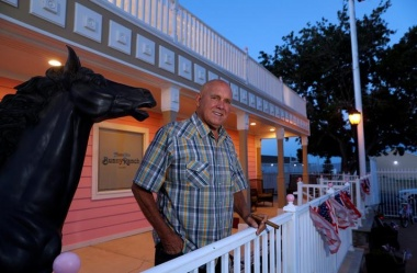 Dennis Hof, owner of the Moonlite BunnyRanch legal brothel and recent winner of the Republican primary election for Nevada State Assembly District 36, poses outside the brothel in Mound House, Nevada, U.S. June 16, 2018. REUTERS/Steve Marcus