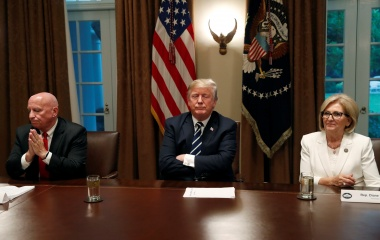 U.S. President Donald Trump sits between Rep. Kevin Brady (R-TX) and Rep. Diane Black (R-TN) at the start of a meeting with members of the U.S. Congress at the White House in Washington, July 17, 2018. REUTERS/Leah Millis