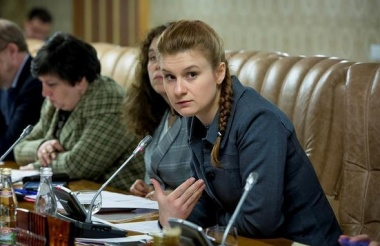 Maria Butina (R) attends a meeting of a group of experts, affiliated to the government of Russia, in this undated handout photo obtained by Reuters on July 17, 2018. Press Service of Civic Chamber of the Russian Federation/Handout via REUTERS