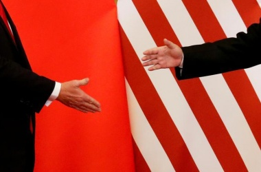 U.S. President Donald Trump and China's President Xi Jinping shake hands after making joint statements at the Great Hall of the People in Beijing, China, November 9, 2017. REUTERS/Damir Sagolj/File Photo/File Photo