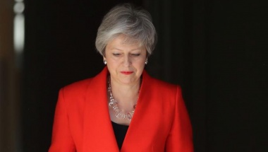 FILE PHOTO: British Prime Minister Theresa May arrives to deliver a statement in London, Britain, May 24, 2019. REUTERS/Simon Dawson