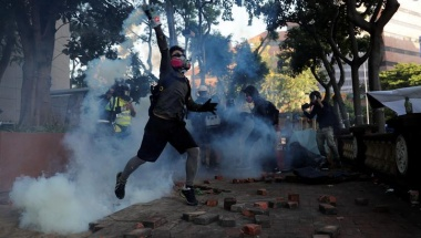 A protester hurls a projectile towards police during clashes at Hong Kong Polytechnic University November 18, 2019. REUTERS/Tyrone Siu