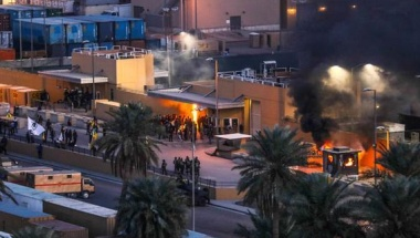 Protesters set fire to an entry control point at the U.S. Embassy in Baghdad, December 31, 2019. U.S. Army/Staff Sgt. Desmond Cassell/Task Force-Iraq Public Affairs/Handout via REUTERS