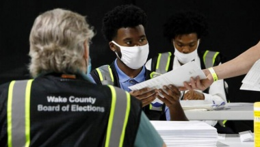 Poll workers prepare absentee ballots for shipment at the Wake County Board of Elections in Raleigh, North Carolina, September 4, 2020. REUTERS/Jonathan Drake/File Photo