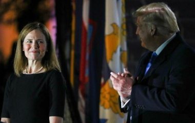 Judge Amy Coney Barrett looks over at President Trump before Barrett is sworn in to serve as an associate justice of the Supreme Court on the South Lawn of the White House in Washington, October 26, 2020. REUTERS/Tom Brenner