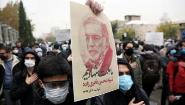 A protester holds a picture of Mohsen Fakhrizadeh, Iran's top nuclear scientist, during a demonstration against his killing in Tehran, Iran, November 28, 2020. Majid Asgaripour/WANA (West Asia News Agency) via REUTERS