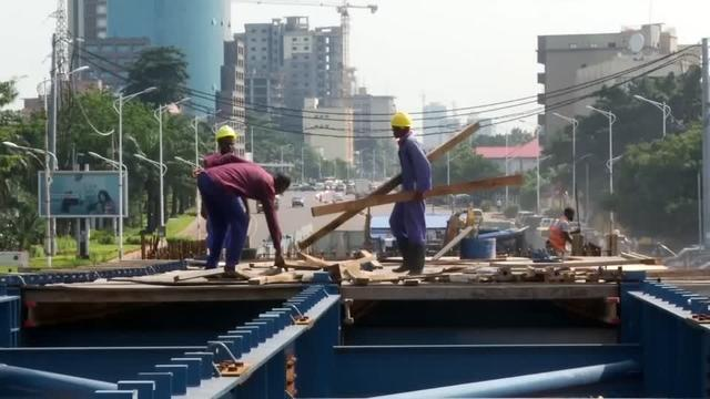 Congolese President Felix Tshisekedi is facing a crisis as his pet project, sleek overpasses above Kinshasa's gridlocked streets, lies part complete - causing commuter chaos. David Doyle reports.