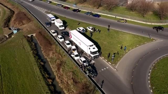 Drone footage near one of the quarantined small towns in northern Italy on Monday shows cars lined up waiting to be checked by police. Italy is the European country worst-hit by the coronavirus outbreak.
