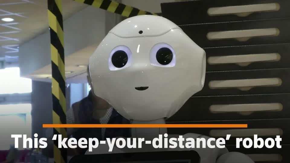 Keep-your-distance robot puts smiles on faces of stressed German shoppers | Reuters Video