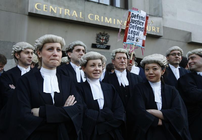 UK barristers stage first ever strike over legal aid cuts | Reuters