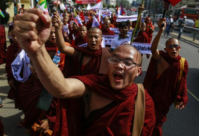 Myanmar president enacts law allowing referendum on disputed ...