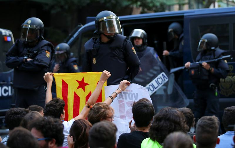 Spanish police raid Catalan government to halt banned referendum