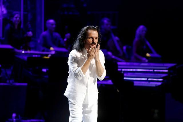 FILE PHOTO: Composer Yanni reacts during the concert at Princess Nourah bint Abdulrahman University in Riyadh, Saudi Arabia, December 3, 2017. REUTERS/Faisal Al Nasser/File Photo