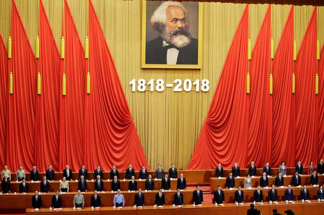 Chinese President Xi Jinping and other officials sing the national anthem at an event commemorating the 200th birth anniversary of Karl Marx, in Beijing, China May 4, 2018. REUTERS/Jason Lee