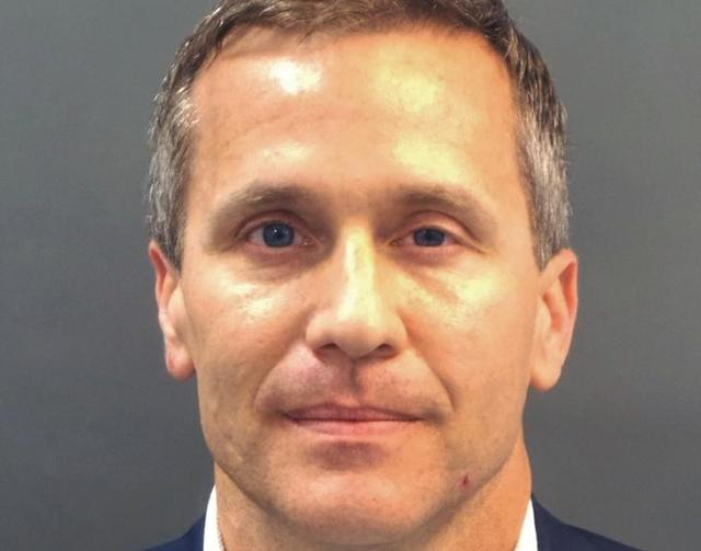 Missouri Governor Eric Greitens appears in a police booking photo in St.  Louis, Missouri
