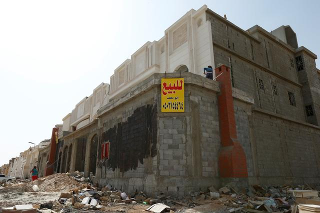 A for-sale banner is placed on a private villa under construction, near  Riyadh