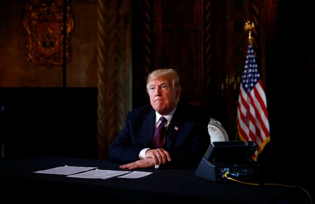 U.S. President Donald Trump takes questions from the media after speaking via teleconference with troops from Mar-a-Lago estate in Palm Beach, Florida, U.S., November 22, 2018. REUTERS/Eric Thayer