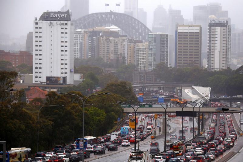'Once-in-100-year' storm triggers Sydney chaos as heat fans Queensland fires