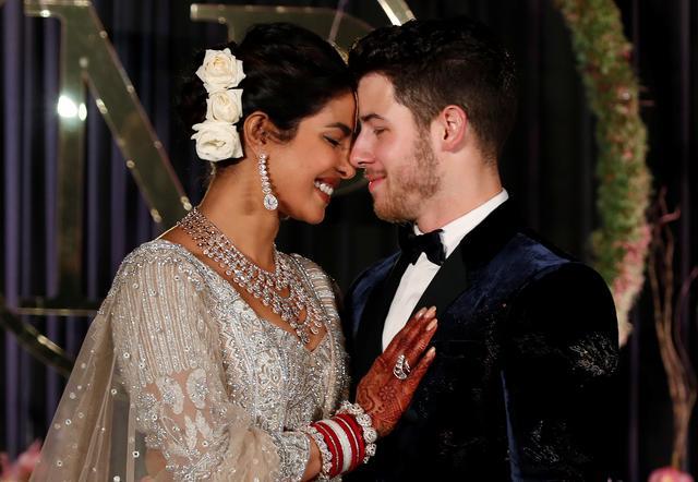 Bollywood Actress Priyanka Chopra And Her Husband Singer Nick Jonas Pose During A Photo Opportunity At