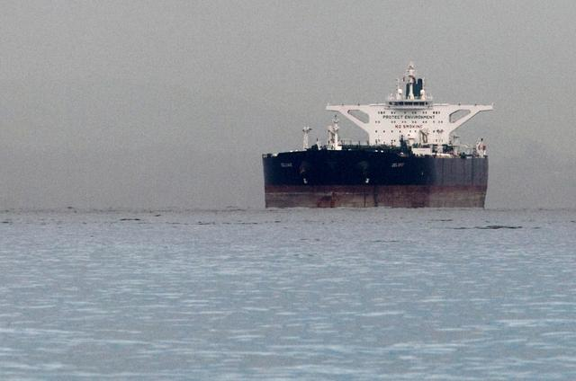 "FILE PHOTO: Malta-flagged Iranian crude oil supertanker ""Delvar"" is seen anchored off Singapore March 1, 2012. . REUTERS/Tim Chong/File Photo"
