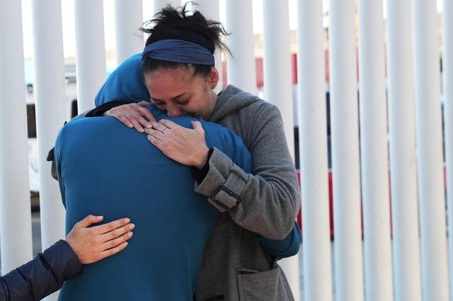 People embrace near the Chaparral border crossing  in Tijuana, Mexico, January 25, 2019. REUTERS/Shannon Stapleton