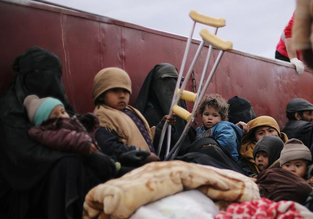 Children sit at a back of a truck near the village of Baghouz, Deir Al Zor province, Syria February 27, 2019. REUTERS/Rodi Said