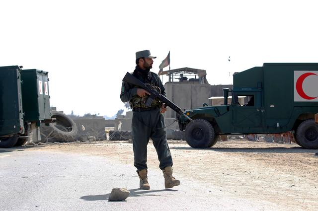 An Afghan police officer stands guard near the site of an attack in Jalalabad, Afghanistan March 6, 2019. REUTERS/Parwiz