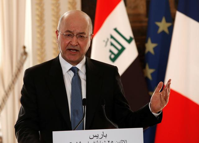 Iraqi President Barham Salih speaks during a news conference at the Elysee Palace in Paris, France, February 25, 2019. Christophe Ena/Pool via REUTERS